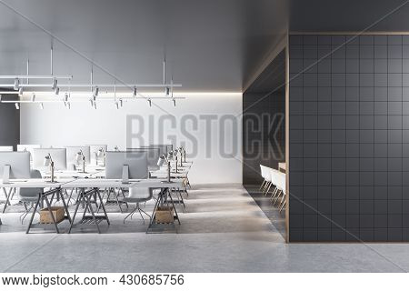 Modern Coworking Office Interior With Black Tile Partition, Equipment, Furniture And Daylight. 3d Re
