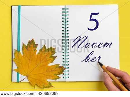 5th Day Of November. Hand Writing The Date 5 November In An Open Notebook With A Beautiful Natural M