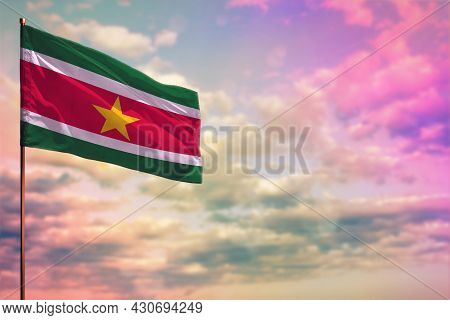 Fluttering Suriname Flag Mockup With The Place For Your Text On Colorful Cloudy Sky Background.