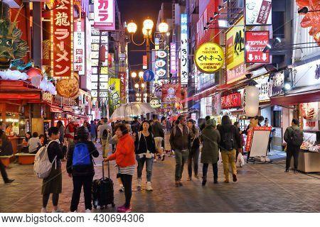 Osaka, Japan - November 21, 2016: People Visit Night Dotonbori Street In Osaka, Japan. Dotonbori Is