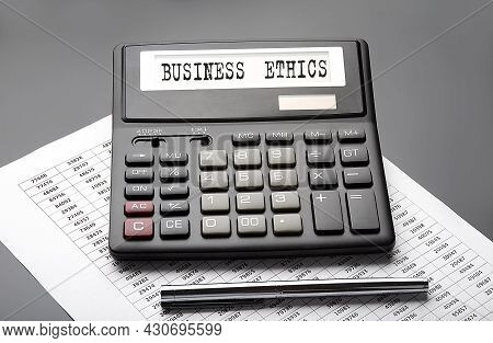 Business Ethics Word On The Calculator On Chart With Pen