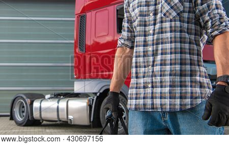 Professional Cdl Semi Truck Driver In His 40s Preparing For Another Trip In Front Of His Modern Red
