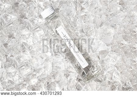 Tallinn, Estonia- April 12.2021: Haage Mineral Carbonated Water In Glass Bottle On Ice. Haage Is Nat