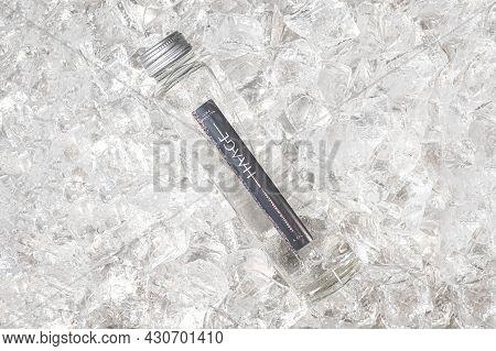 Tallinn, Estonia- April 12.2021: Haage Mineral Still Water In Glass Bottle On Ice. Haage Is Natural