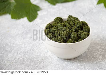 Fermentation Of Currant Leaves By Granulation Method For Herbal Tea At Home. Bowl With Fermented Gra