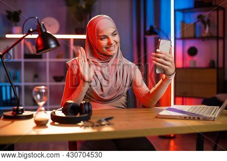 Attractive Arabian Woman Using Modern Cell Phone For Taking Selfie. Positive Young Female In Hijab S