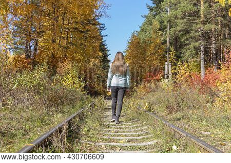 Hipster Young Woman  Walking Along Old Railway. Back View, Faceless. Hiking Concept, Activity Touris