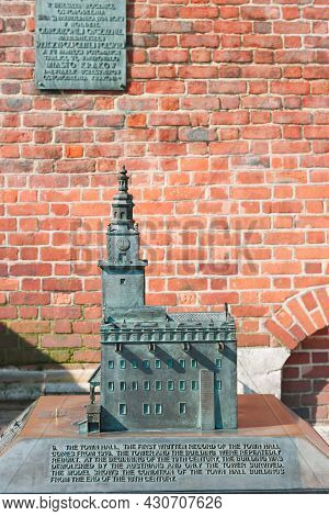 Krakow,poland-june 6, 2021,the Bronze Model Of Town Hall Tower At The Main Market Square In Old Town