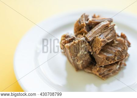 Canned Beef Stew On White Plate With Parsley Leaf, Yellow Background