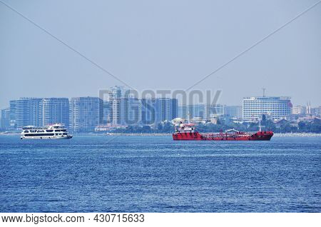Panoramic View Of The Bosphorus. View Of The Ships Sailing Along The Strait And High-rise Buildings