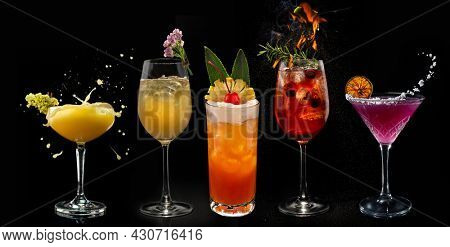Alcohol cocktails: Daiquiri mango, margarita, Mai Tai, Forest aperol on black background.