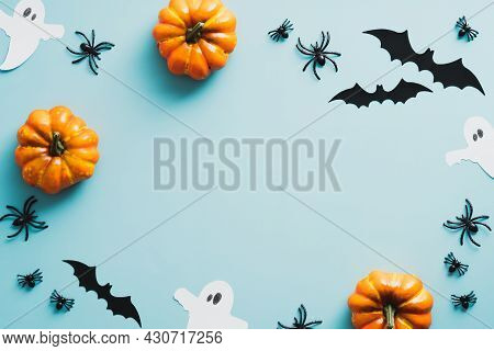 Happy Halloween Holiday Concept. Frame Of Halloween Decorations, Bats, Ghosts, Pumpkins, Spiders On