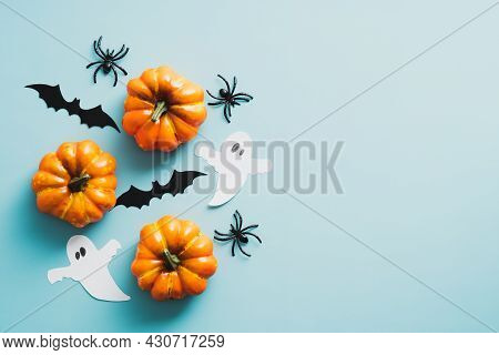 Happy Halloween Holiday Concept. Halloween Decorations, Bats, Ghosts, Pumpkins On Blue Background. H