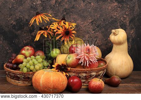 Autumn Background With Seasonal Nature Autumn Berries, Pumpkins, Apples, Grapes, Melons And Flowers