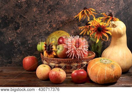 Happy Thanksgiving Concept, Autumn Background With Seasonal Pumpkins, Melons, Apples And Flowers On