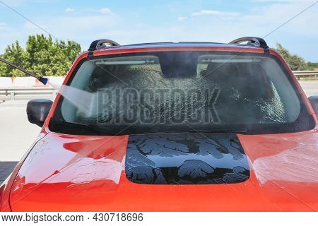Hand Car Wash With High Pressure Water In An Outdoor Car Wash