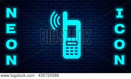 Glowing Neon Smartphone With Free Wi-fi Wireless Connection Icon Isolated On Brick Wall Background.