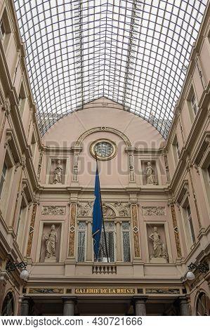 Brussels, Belgium - July 31, 2021: Closeup Of Dividing Statue Wall In Galerie De La Reine, Oldest Co