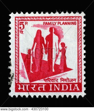 ZAGREB, CROATIA - SEPTEMBER 13, 2014: Stamp printed in India shows silhouette of a family to commemorate family planning campaign, circa 1967