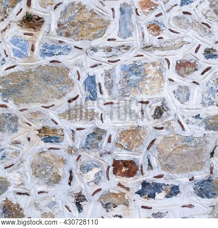 Seamless Texture Of Asymmetric Masonry Made Of Multicolored Stones. Top View.