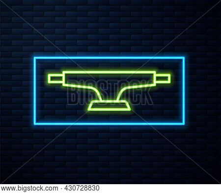 Glowing Neon Line Skateboard Wheel Icon Isolated On Brick Wall Background. Skateboard Suspension. Sk