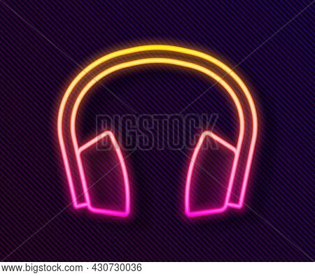 Glowing Neon Line Noise Canceling Headphones Icon Isolated On Black Background. Headphones For Ear P