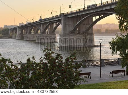 Large Automobile Arched Bridge Over The River Ob, Embankment With Trees, Benches. Russia, Siberia, 2
