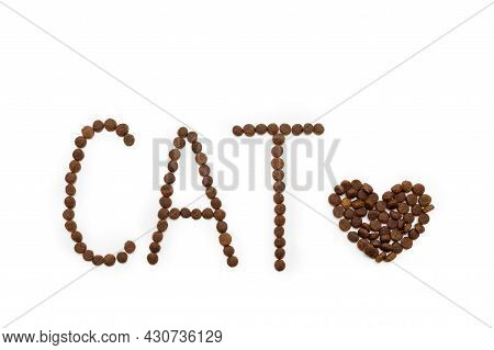 Dry Dog Food In The Shape Of A Heart And Letters Cat Isolated On White Background, Copy Space, Top V