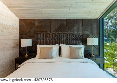 White Bed,  Quilt And Pillows In  Wooden Bedroom.  Hotel Bedroom.  Comfortable Bed With Soft Blanket
