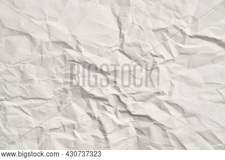 White crumpled paper texture with wrinkles. Damaged and torn sheet