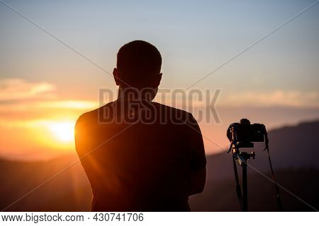 Professional Nature Photographer In Mountain With Sunset. Photography Concept