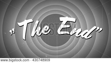 Digital image of a white The End sign appearing in the screen and grey circle patterns with static in the background