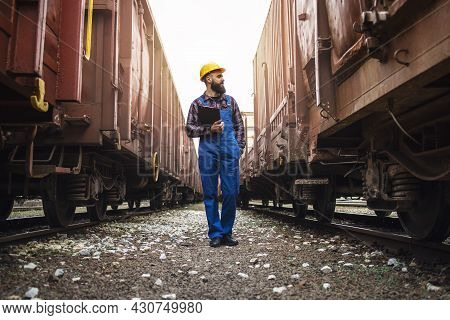 Railway Transportation Supervisor Checking Trains And Cargo.