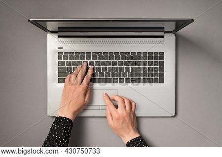 First Person Top View Photo Of Hands Using Laptop Touchpad And Typing On Keyboard On Isolated Grey B