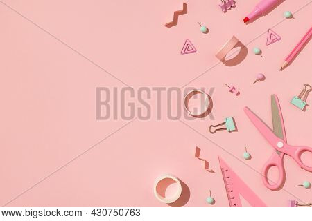 Top View Photo Of School Supplies Pastel Pink And Green Stationery Adhesive Tapes Pushpins Binder Cl