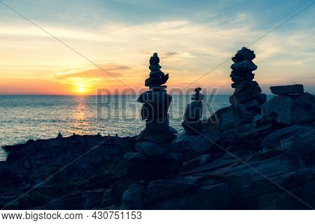 Zen Concept. The Object Of The Stones On The Rock At Sunset. Zen Stones.