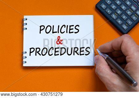 Policies And Procedures Symbol. Businessman Writing Words 'policies And Procedures' On White Note. B