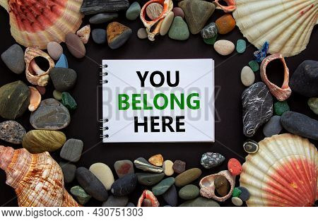 Inclusion And Belonging Symbol. Words You Belong Here On A Beautiful White Note, Black Background. S