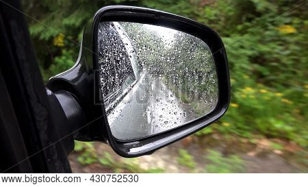 Traffic In Rain, Driving Car In Raining, Rainy Drops View On Mirror Window Glass, Storm On Road High