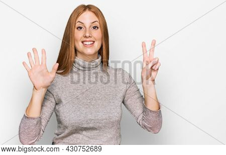 Young irish woman wearing casual clothes showing and pointing up with fingers number seven while smiling confident and happy.