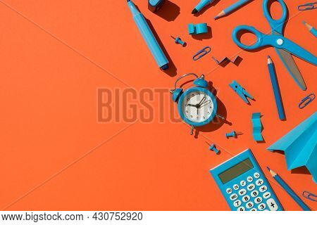 Top View Photo Of Blue School Supplies Stationery Calculator Markers Pencils Clips Pushpins Scissors