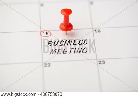 Closeup Photo Of Mark On Calendar At Fifteenth Inscription Business Meeting With Red Pushpin