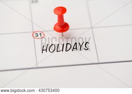 Closeup Photo Of Mark On Calendar At Thirty-first Inscription Holidays With Red Pushpin
