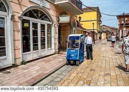Shkoder, Albania - June 21, 2021: An Old Man And His Golf Car On The Rruga G'juhadol Pedestrian Stre