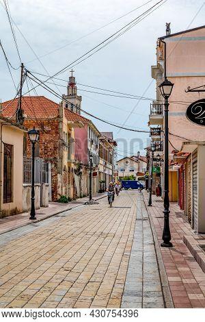Shkoder, Albania - June 21, 2021: Cyclists Ride On Rruga G'juhadol Pedestrian Street In Shkoder, Ver