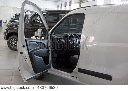 Russia, Izhevsk - August 20, 2021: Fiat Showroom. Interior Of New Doblo Cargo Van In Dealer Showroom