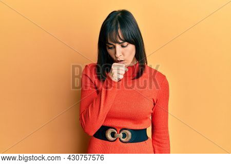 Young hispanic woman wearing casual clothes feeling unwell and coughing as symptom for cold or bronchitis. health care concept.