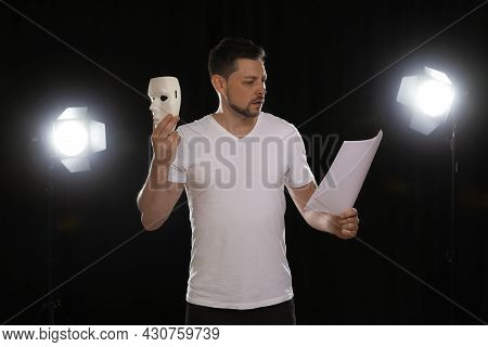 Professional Actor Reading His Script During Rehearsal In Theatre