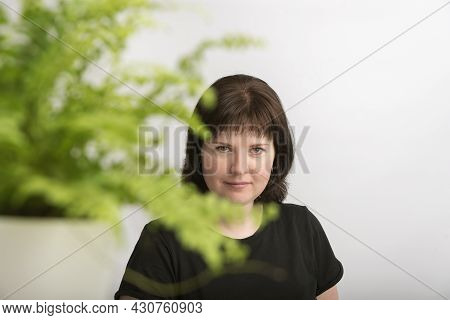 Portrait Of Beautiful Young Woman With Natural Dark Hair In Isolation On White Background With Brigh