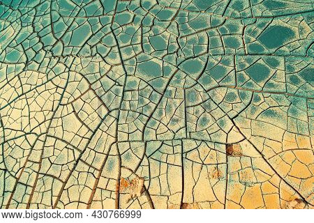 Cracked earth at the site of a dried  lake. Global climate change concept